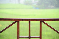 Wooden rail of hose terrace in raining. Relax time Royalty Free Stock Photo