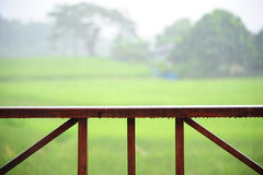 Wooden rail of hose terrace in raining. Relax time Royalty Free Stock Photos