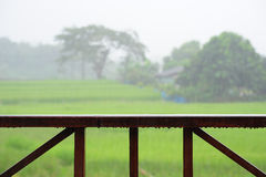 Wooden rail of hose terrace in raining. Relax time Stock Photo