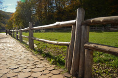 Wooden railing. Wooden fence of sticks which leads along the path of the stumps Stock Photography