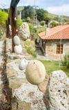 Wooden railing with hanged stones. Natural wooden railing with decorative hanged stones Stock Photo