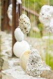 Wooden railing with hanged stones. Natural wooden railing with decorative hanged stones Royalty Free Stock Photography