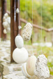 Wooden railing with hanged stones Stock Photos