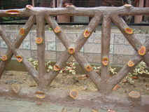 Wooden railing in a park. Wooden railing in malsi deer park located in dehradun royalty free stock images