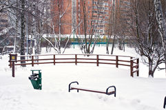 Wooden railings and bench in snow Royalty Free Stock Images