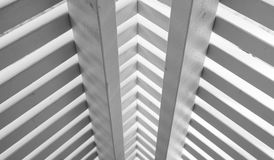 Wooden railings corner made of planks. Abstract white wooden architecture fragment, railings corner made of planks. Close up photo with selective focus Stock Photography