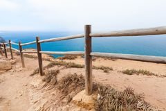 Wooden railings on the edge of Cabo da Roca. Westernmost point Portugal and Europe Royalty Free Stock Photo