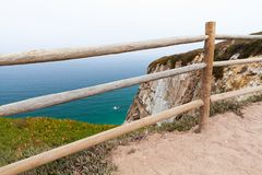 Wooden railings on the edge of Cabo da Roca. Westernmost point Portugal and Europe Stock Image