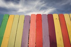 Wooden Rainbow Fence with blue sky Royalty Free Stock Photos