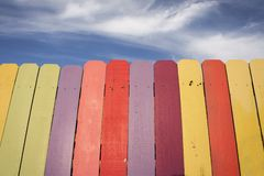 Wooden Rainbow Fence with blue sky Royalty Free Stock Images