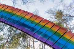 Wooden rainbow in forest Stock Images