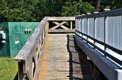 Wooden Ramp Leading to Metal Dock Near Electrical Junction Box stock photo