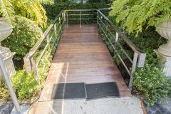 Wooden ramp way for support wheelchair disabled people in to coffee shop. royalty free stock photography