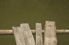 Pond. Wooden ramshackle walkway over old green pond Royalty Free Stock Photos