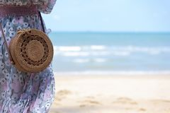 Wooden rattan  Bali bag with beach at background. During summer travel stock images
