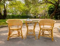 Wooden Rattan Chairs with Set of Tea on Table for Afternoon Tea Stock Images
