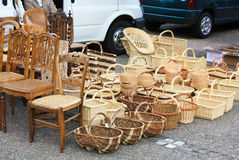 Wooden and rattan objects for sale. Chairs, baskets and other wooden and rattan products sold on the street Stock Photo