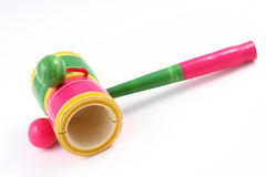 Wooden rattle. On white background Stock Photos