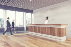 Wooden reception counter, side people Royalty Free Stock Images