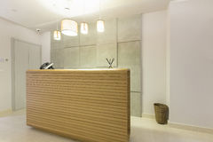 Wooden reception desk in spa center.  Royalty Free Stock Images