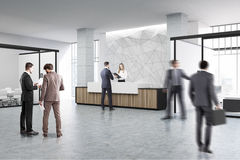 Wooden reception and meeting room, people Royalty Free Stock Images