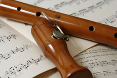 Wooden recorder and sheet music Stock Photos