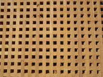 Wooden, rectangular wood with holes Stock Image