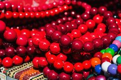 Wooden red beads on the market Stock Image