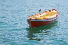 Wooden red boat in a calm lake Royalty Free Stock Photo