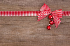 Wooden red christmas background with a white checked ribbon Stock Image