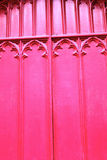 Wooden red church door close up Stock Image