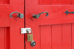 Wooden red door with handle. Closeup of old wooden red door with metal handle Royalty Free Stock Photography