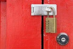 Wooden red door with padlock. Closeup of old wooden red door with padlock Royalty Free Stock Photography