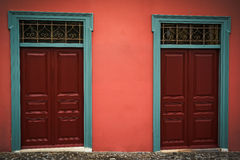Wooden red doors. Traditional wooden red doors in the center of Athens Royalty Free Stock Images