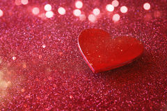 Wooden red hearts on red shiny background Stock Images