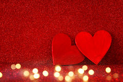 Wooden red hearts on red shiny background Royalty Free Stock Photography