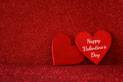 Wooden red hearts on red shiny background Royalty Free Stock Photos