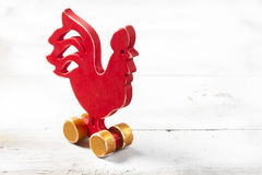 Wooden red rooster. New Year Stock Image