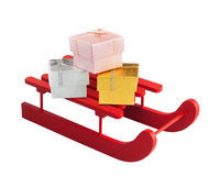 Wooden red sled with gift boxes Royalty Free Stock Photo