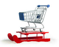 Wooden red sled with shopping cart Stock Photos