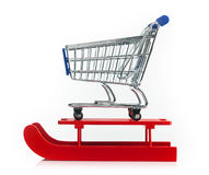 Wooden red sled with shopping cart Royalty Free Stock Image