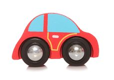 Wooden red toy car. Cutout Royalty Free Stock Images