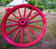 Wooden red wagon wheel Royalty Free Stock Image