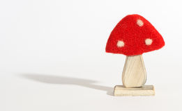 Wooden red and white spotted mushroom ornament Royalty Free Stock Images