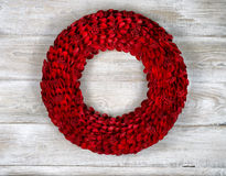 Wooden Red Wreath on White aged boards Stock Image