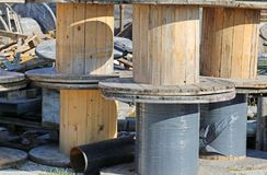 Wooden reels in landfills. Wooden reels for electrical cables in landfills stock images