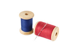 A wooden reels of thread. On white background Stock Photo