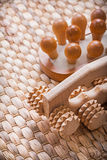 Wooden refreshing massager on wicker mat Royalty Free Stock Images