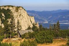 Wooden refuge in mountain landscape Stock Images