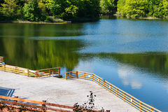 Wooden relaxing area on the sovata lake Royalty Free Stock Photos